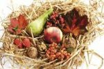 Thumbnail Autumn decoration in straw, pear, apple, autumn leaves, walnuts, firethorn