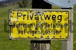 Thumbnail yellow sign privat way trespassing on your own risk