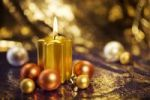 Thumbnail Christmas decorations with a burning golden candle