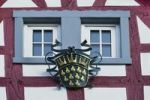 Thumbnail Wrought-iron coat of arms of the independent city of Cologne on a beautifully decorated half-timbered house