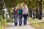 Thumbnail Three young women walking through a park