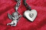 Thumbnail Costume jewellery, Cupid with bow and arrow and a heart on a chain