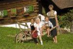 Thumbnail Farmwoman with children on a farm
