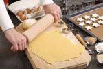 Thumbnail Baking Christmas cookies, woman rolling out cookie dough with a rolling pin