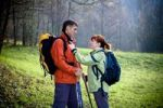 Thumbnail Couple hiking through a forest in autumn