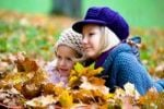 Thumbnail Two girls, sisters, in a park in autumn