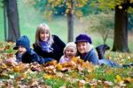 Thumbnail Mother and three children in a park in autumn