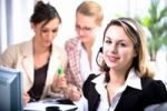 Thumbnail Young woman using a headset in an office