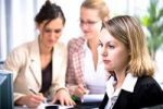 Thumbnail Young woman with her colleagues in an office