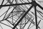 Thumbnail View from below looking up in an electricity pylon, black and white