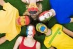 Thumbnail Young people with faces painted in different national colours