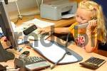 Thumbnail little girl working in office