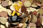 Thumbnail Figure of a construction worker with hard hat and shovel on Euro coins