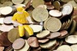 Thumbnail Figure of a construction worker with hard hat and pickaxe on Euro coins