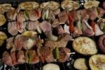 Thumbnail Grill meat and vegetabels on skewers on a barbecue grid