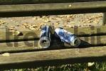 Thumbnail empty beer cans on a bench