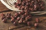 Thumbnail Dried Jujube berries (Ziziphus jujuba) as an ingredient for breakfast cereals, cakes and pastries, tipped out of a willow basket