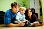 Thumbnail Young family playing with a game console