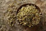 Thumbnail German Chamomile (Matricaria chamomilla), blossoms, in a copper bowl on a stone surface