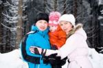 Thumbnail Young family in the snowy woods