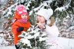 Thumbnail Little girl and her mother in the snowy woods