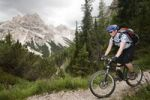 Thumbnail Mountain biker on trail in front of Mt Seekofel, South Tyrol, Italy, Europe