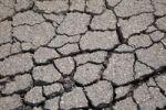 Thumbnail Dry, cracked asphalt in winter