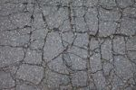 Thumbnail Asphalt cracked by frost and cold, potholes in Berlin, Germany, Europe