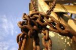 Thumbnail Rusty chains around a steel beam