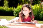 Thumbnail Girl reading a book in the garden
