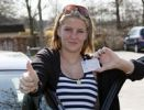Thumbnail 18-year-old woman proudly showing her new driving licence
