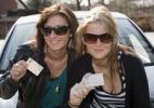 Thumbnail Two young women proudly showing their driving licences