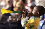 Thumbnail Small South African boy as a fan of the national football team of South Africa for the 2010 World Cup with Vuvuzela and flag