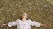 Thumbnail 8-year-old girl spreading her arms and watching soap bubbles above her head