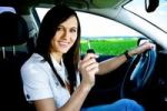 Thumbnail Young woman driving a new car