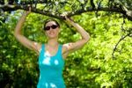 Thumbnail Young woman taking a break while jogging in an orchard
