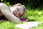 Thumbnail Young woman lying on a meadow, relaxing, Germany, Europe