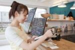 Thumbnail Young woman working in coffee shop
