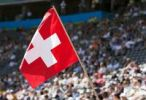 Thumbnail Swiss fan waving the national flag at a sports event