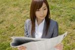 Thumbnail Businesswoman reading newspaper