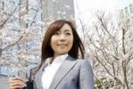 Thumbnail Businesswoman standing under cherry blossom tree
