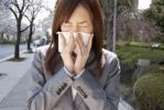 Thumbnail Young woman sneezing