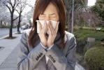 Thumbnail Young woman sneezing