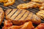 Thumbnail Grilled meat, marinated turkey breast and beef steaks on a grill