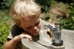 Thumbnail Boy, three years, drinking water from a public tap, Spain, Europe