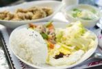Thumbnail Chinese food with rice, egg, cabbage, fried chicken and soup on the table