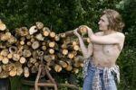 Thumbnail Farmer lifting a log