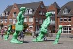 Thumbnail Green sculptures, Reisende Riesen im Wind or Travelling Giants in the Wind, by the artist Martin Wolke in front of the station in Westerland on Sylt island, Schleswig-Holstein, Germany, Europe