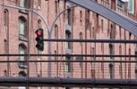 Thumbnail Pedestrian bridge with traffic lights in the Speicherstadt historic warehouse district in Hamburg, Germany, Europe
