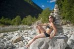 Thumbnail Woman in bikini next to a stone pyramid, Valle Verzasca, Tessin, Switzerland, Europe